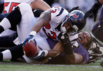 BALTIMORE, MD - OCTOBER 16:  Terrence Cody #62 of the Baltimore Ravens looses his helmet with tackling running back  Arian Foster #23 of the Houston Texans at M&T Bank Stadium on October 16, 2011 in Baltimore, Maryland. The Ravens won 29-14.  (Photo by Ro