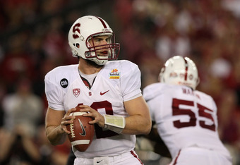 GLENDALE, AZ - JANUARY 02:  Quarterback Andrew Luck #12 of the Stanford Cardinal looks to pass against the Oklahoma State Cowboys during the Tostitos Fiesta Bowl on January 2, 2012 at University of Phoenix Stadium in Glendale, Arizona.  (Photo by Donald M
