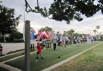 Tom Burnett's 6-year old son in the forefront on the range with the world's best junior golfers.