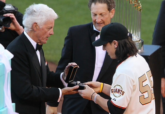 SAN FRANCISCO, CA - APRIL 09:  Tim Lincecum #55 of the San Francisco Giants receives his World Series ring from Giants owner Bill Neukom (L) and Giants President Larry Baer before the start of the game against the St. Louis Cardinals at AT&T Park on April