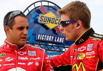 DOVER, DE - OCTOBER 01: Juan Pablo Montoya (L), driver of the #42 Target Chevrolet, talsk with Jamie McMurray (R), driver of the #1 McDonald's Chevrolet, during qualifying for the NASCAR Sprint Cup Series AAA 400 at Dover International Speedway on October