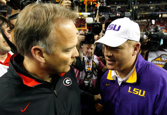 Mark Richt meets LSU Coach Les Miles following the LSU win in the Georgia Dome.