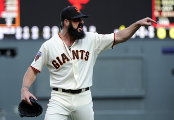 SAN FRANCISCO, CA - APRIL 8: Brian Wilson #38 of the San Francisco Giants after being taken out of the game against the St. Louis Cardinals in the 9th inning let home-plate umpire Bruce Dreckman know how he felt about balls and strike calls during a MLB b