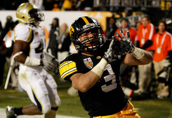 MIAMI GARDENS, FL - JANUARY 05:  Brandon Wegher #3 of the Iowa Hawkeyes celebrates after he scored a 32-yard rushing touchdown late in the fourth quarter against the Georgia Tech Yellow Jackets during the FedEx Orange Bowl at Land Shark Stadium on January