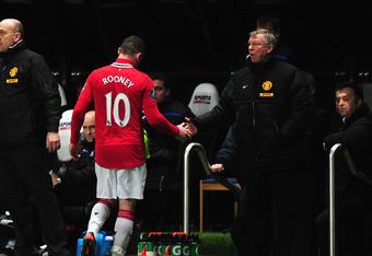 Sir Alex Ferguson needs to decide how to play Wayne Rooney.
