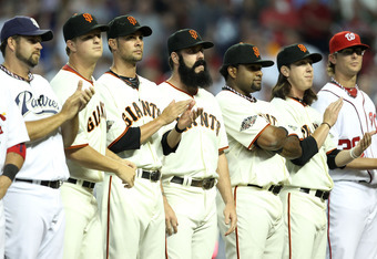 PHOENIX, AZ - JULY 12:  (Center) National League All-Star Brian Wilson #38 of the San Francisco Giants stands with National League All-Star teammates before the start of the 82nd MLB All-Star Game at Chase Field on July 12, 2011 in Phoenix, Arizona.  (Pho