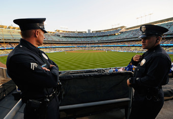 LOS ANGELES, CA - APRIL 14:  Los Angeles Police Department officers look out from an outfield pavillion at Dodger Stadium prior to the start of the baseball game between the St. Louis Cardinals and Los Angeles Dodgers on April 14, 2011 in Los Angeles, Cal