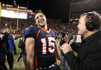 DENVER, CO - JANUARY 08:  Tim Tebow #15 of the Denver Broncos talks to the media after defeating the Pittsburgh Steelers in overtime of the AFC Wild Card Playoff game at Sports Authority Field at Mile High on January 8, 2012 in Denver, Colorado. The Denve