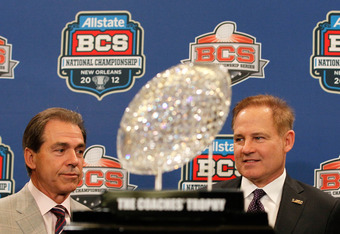 NEW ORLEANS, LA - JANUARY 08:  Head coach Nick Saban of the Alabama Crimson Tide and head coach Les Miles of the LSU Tigers pose with The Coaches' Trophy during the Allstate BCS Championship Press Conference on January 8, 2012 in New Orleans, Louisiana.