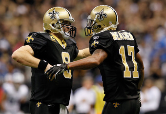 NEW ORLEANS, LA - JANUARY 07:  Drew Brees #9 and  Robert Meachem #17 of the New Orleans Saints celebrate after their touchdown in the fourth quarter against the Detroit Lions during their 2012 NFC Wild Card Playoff game at Mercedes-Benz Superdome on Janua