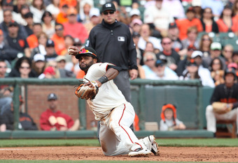 SAN FRANCISCO, CA - SEPTEMBER 14: Pablo Sandoval #48 of the San Francisco Giants fields a ground ball and throws to first base from his knees for an out at AT&T Park on September 14, 2011 in San Francisco, California.  (Photo by Tony Medina/Getty Images)