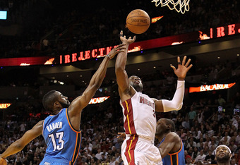MIAMI, FL - MARCH 16:  Dwyane Wade #3 of the Miami Heat is fouled by James Harden #13 of the Oklahoma City Thunder during a game at American Airlines Arena on March 16, 2011 in Miami, Florida. NOTE TO USER: User expressly acknowledges and agrees that, by