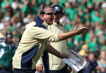 SOUTH BEND, IN - SEPTEMBER 04: Head coach Brian Kelly of the Notre Dame Fighting Irish complains to a referee during a game against the Purdue Boilermakers at Notre Dame Stadium on September 4, 2010 in South Bend, Indiana. Notre Dame defeated Purdue 23-12