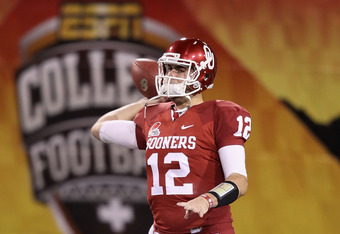 TEMPE, AZ - DECEMBER 30:  Quarterback Landry Jones #12 of the Oklahoma Sooners warms up before the Insight Bowl against the Iowa Hawkeyes at Sun Devil Stadium on December 30, 2011 in Tempe, Arizona.  The Sooners defeated the Hawkeyes 31-14.  (Photo by Chr