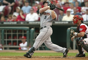 CINCINNATI - MAY 21:  Jeff Bagwell of the Houston Astros eyes his batted ball as Jason LaRue of the Cincinnati Reds watches during the game on May 21, 2004 at Great American Ballpark in Cincinnati, Ohio.  The Reds defeated the Astros 7-4.  (Photo by Andy