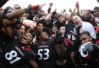 CINCINNATI, OH - DECEMBER 03:  Head Coach Butch Jones of the Cincinnati Bearcats celebrates with his team after the Bearcats defeated the Connecticut Huskies 35-27 to claim their share of the 2011 Big East Championship on December 3, 2011 at Nippert Stadi