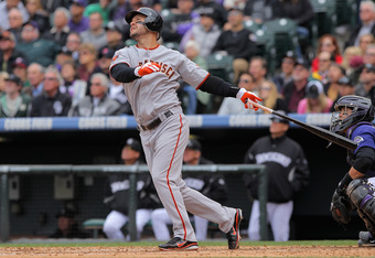 DENVER, CO - APRIL 20:  Cody Ross #13 of the San Francisco Giants takes an at bat against the Colorado Rockies at Coors Field on April 20, 2011 in Denver, Colorado.  (Photo by Doug Pensinger/Getty Images)