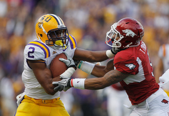 BATON ROUGE, LA - NOVEMBER 25:  Rueben Randle #2 of the Louisiana State University Tigers is tackled by Tramain Thomas #5 of the Arkansas Razorbacks at Tiger Stadium on November 25, 2011 in Baton Rouge, Louisiana.  (Photo by Chris Graythen/Getty Images)