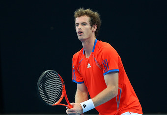 BRISBANE, AUSTRALIA - JANUARY 08:  Andy Murray of Great Britain waits to return serve against Alexandr Dolgopolov of the Ukraine in the Men's finals match during day eight of the 2012 Brisbane International at Pat Rafter Arena on January 8, 2012 in Brisba