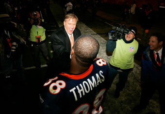 DENVER, CO - JANUARY 08:  Demaryius Thomas #88 of the Denver Broncos celebrates with John Elway, Executive Vice President of Football Operations for the Denver Broncos, after running the ball against the Pittsburgh Steelers to score an 80 yard touchdown i