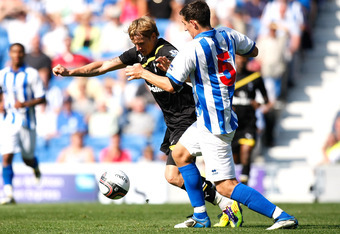 BRIGHTON, ENGLAND - JULY 30:  Roman Pavlyuchenko of Tottenham Hotspur and Lewis Dunk of Brighton & Hove Albion battle for the ball during the Pre Season Friendly match between Brighton & Hove Albion and Tottenham Hotspur at Amex Stadium on July 30, 2011 i