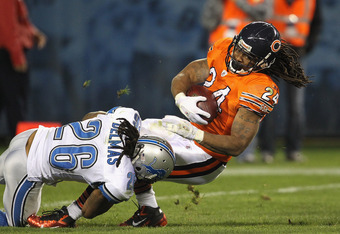 CHICAGO, IL - NOVEMBER 13:  Marion Barber #24 of the Chicago Bears is tackled by Louis Delmas #26 of the Detroit Lions at Soldier Field on November 13, 2011 in Chicago, Illinois. The Bears defeated the Lions 37-13.  (Photo by Jonathan Daniel/Getty Images)