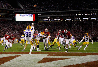TUSCALOOSA, AL - NOVEMBER 05:  Brad Wing #38 of the LSU Tigers punts from the end zone during the second half of the game against the Alabama Crimson Tide at Bryant-Denny Stadium on November 5, 2011 in Tuscaloosa, Alabama.  (Photo by Streeter Lecka/Getty