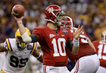 NEW ORLEANS, LA - JANUARY 09:  AJ McCarron #10 of the Alabama Crimson Tide passes against the Louisiana State University Tigers during the 2012 Allstate BCS National Championship Game at Mercedes-Benz Superdome on January 9, 2012 in New Orleans, Louisiana