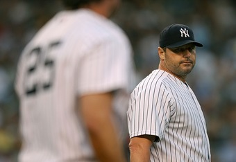 NEW YORK - AUGUST 29:  Pitcher Roger Clemens #22 of the New York Yankees looks over at first baseman Jason Giambi #25 after Giambi made a diving stop  during a game against the Boston Red Sox on August 29, 2007 at Yankee Stadium in the Bronx borough of Ne