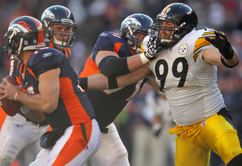 DENVER, CO - JANUARY 08:  Right guard Russ Hochstein #71 of the Denver Broncos blocks the rush of defensive end Brett Keisel #99 of the Pittsburgh Steelers to protect the blindside of quarterback Tim Tebow #15 of the Denver Broncos at Sports Authority Fie