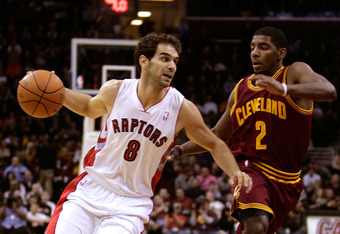 CLEVELAND, OH - DECEMBER 26: Jose Calderon #8 of the Toronto Raptors drives to the basket against Kyrie Irving #2 of the Cleveland Cavaliers during the season opener at Quicken Loans Arena on December 26, 2011 in Cleveland, Ohio. NOTE TO USER: User expres