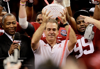 NEW ORLEANS, LA - JANUARY 09:  Head coach Nick Saban of the Alabama Crimson Tide celebrates with the trophy after defeating Louisiana State University Tigers in the 2012 Allstate BCS National Championship Game at Mercedes-Benz Superdome on January 9, 2012