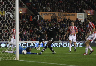STOKE ON TRENT, ENGLAND - OCTOBER 31:  Demba Ba (C) of Newcastle United scores his sides second goal during the Barclays Premier League match between Stoke City and Newcastle United at the Britannia Stadium on October 31, 2011 in Stoke on Trent, England.