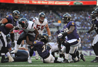 BALTIMORE - OCTOBER 16:  Ben Tate #44 of the Houston Texans fumbles the ball in the end zone against the Baltimore Ravens at M&T Bank Stadium on October 16. 2011 in Baltimore, Maryland. The ball was recovered by the Texans for a touchdownThe Ravens lead t