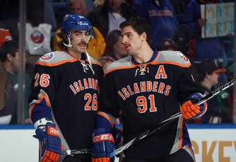 UNIONDALE, NY - NOVEMBER 23: Matt Moulson #26 and John Tavares #91 of the New York Islanders skate in warmups prior to the game against the Philadelphia Flyers at the Nassau Veterans Memorial Coliseum on November 23, 2011 in Uniondale, New York.  (Photo b