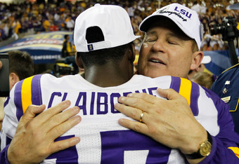 ATLANTA, GA - DECEMBER 03:  Head coach Les Miles and Morris Claiborne #17 of the LSU Tigers celebrate their 42-10 win over the Georgia Bulldogs during the 2011 SEC Championship Game at Georgia Dome on December 3, 2011 in Atlanta, Georgia.  (Photo by Kevin