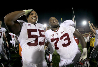 LOS ANGELES, CA - OCTOBER 29: Offensive tackles Jonathan Martin #54 and Cameron Fleming #73 of the Stanford Cardinal celebrate after the game with the USC Trojans at the Los Angeles Memorial Coliseum on October 29, 2011 in Los Angeles, California. Stanfor