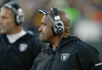 GREEN BAY, WI - DECEMBER 11: Head coach Hue Jackson of the Oakland Raiders looks on during the game against the Green Bay Packers at Lambeau Field on December 11, 2011 in Green Bay, Wisconsin. (Photo by Scott Boehm/Getty Images)
