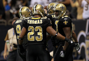 NEW ORLEANS, LA - JANUARY 07:  Devery Henderson #19 of the New Orleans Saints celebrates with teammates  Drew Brees #9 and Pierre Thomas #23 after scoring a touchdown in the third period against the Detroit Lions during their 2012 NFC Wild Card Playoff ga