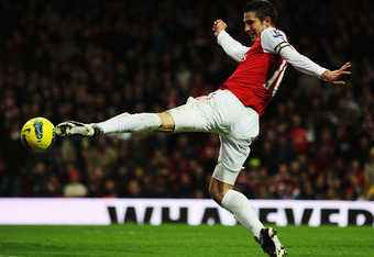 LONDON, ENGLAND - DECEMBER 31:  Robin van Persie of Arsenal controls the ball during the Barclays Premier League match between Arsenal and Queens Park Rangers at the Emirates Stadium on December 31, 2011 in London, England.  (Photo by Clive Mason/Getty Im