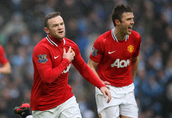 MANCHESTER, ENGLAND - JANUARY 08:  Wayne Rooney of Manchester United celebrates scoring the opening goal during the FA Cup Third Round match between Manchester City and Manchester United at the Etihad Stadium on January 8, 2012 in Manchester, England.  (P