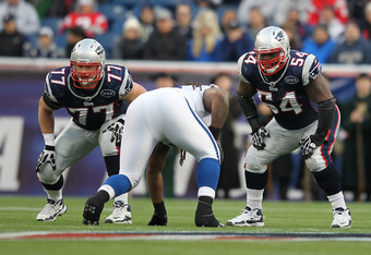 FOXBORO, MA - DECEMBER 4:    Nate Solder #77 of the New England Patriots and  Brian Waters #54 of the New England Patriots line up against the Indianapolis Colts in the first half at Gillette Stadium on December 4, 2011 in Foxboro, Massachusetts. (Photo b