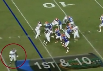 Upshaw drops in zone coverage as Alabama sends the Fire Zone blitz.