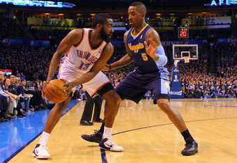 OKLAHOMA CITY, OK - APRIL 27: J.R. Smith #5 of the Denver Nuggets defends against James Harden #13 of the Oklahoma City Thunder in Game Five of the Western Conference Quarterfinals in the 2011 NBA Playoffs on April 27, 2011 at the Ford Center in Oklahoma