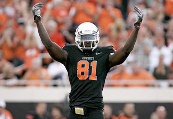 STILLWATER, OK - SEPTEMBER 8:  Wide receiver Justin Blackmon #81 of the Oklahoma State Cowboys gestures to the crowd during the first half of the game against the Arizona Wildcats on September 8, 2011 at Boone Pickens Stadium in Stillwater, Oklahoma.  Okl