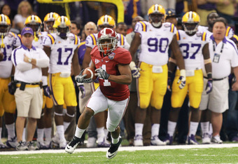 NEW ORLEANS, LA - JANUARY 09:  Marquis Maze #4 of the Alabama Crimson Tide runs with the ball against the Louisiana State University Tigers during the 2012 Allstate BCS National Championship Game at Mercedes-Benz Superdome on January 9, 2012 in New Orlean
