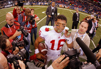 INDIANAPOLIS, IN - DECEMBER 03:  Russell Wilson #16 of the Wisconsin Badgers celebrates after they won 42-39 against the Michigan State Spartans during the Big 10 Conference Championship Game at Lucas Oil Stadium on December 3, 2011 in Indianapolis, India