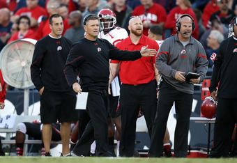 TUCSON, AZ - NOVEMBER 05:  Head coach  Kyle Whittingham of the Utah Utes reacts during the college football game against the Arizona Wildcats at Arizona Stadium on November 5, 2011 in Tucson, Arizona.  The Utes defeated the Wildcats 34-21.  (Photo by Chri