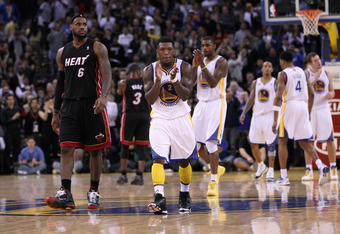 OAKLAND, CA - JANUARY 10:  Nate Robinson #2 of the Golden State Warriors claps his hands in front of LeBron James #6 of the Miami Heat at Oracle Arena on January 10, 2012 in Oakland, California.  NOTE TO USER: User expressly acknowledges and agrees that,