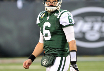 EAST RUTHERFORD, NJ - DECEMBER 24: Mark Sanchez #6 of the New York Jets reacts to the game action during the second half against the New York Giants on December 24, 2011 at MetLife Stadium in East Rutherford, New Jersey. (Photo by Christopher Pasatieri/Ge